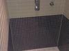 Badkamer amsterdam met mozaiek en een gietvloer